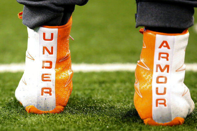 "FILE- In this March 5, 2017, file photo a closeup of Under Armour cleats are seen before a drill at the 2017 NFL football scouting combine in Indianapolis. Under Armour received a warning from U.S. regulators that the company and two executives could be punished over past accounting practices. The sporting goods company said in a government filing Monday, July 27, 2020, that the warning, known as a ""Wells Notice,"" was sent last week from the U.S. Securities and Exchange Commission.  (AP Photo/Gregory Payan, File)"