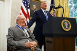President Donald Trump speaks during a Presidential Medal of Freedom ceremony for former NBA basketball player and coach Bob Cousy, of the Boston Celtics, in the Oval Office of the White House, Thursday, Aug. 22, 2019, in Washington. (AP Photo/Alex Brandon)