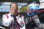 Tony Kanaan, of Brazil, wipes his face during qualifications for the Indianapolis 500 auto race at Indianapolis Motor Speedway, Saturday, Aug. 15, 2020, in Indianapolis. (AP Photo/Darron Cummings)