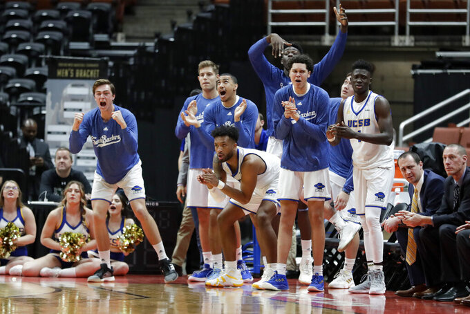 UC Santa Barbara players celebrates during the second half of a NCAA college basketball game against Cal State Northridge at the Big West men's tournament in Anaheim, Calif., Thursday, March 14, 2019. UCSB won 71-68. (AP Photo/Chris Carlson)