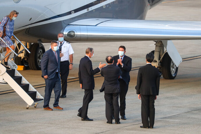 U.S. Under Secretary of State Keith Krach, second right, reacts as he is greeted after disembarking from a plane upon arrival at the airport in Taipei. Taiwan, on Thursday, Sept. 17, 2020. Krach is in Taiwan on Thursday for the second visit by a high-level American official in two months, prompting a stern warning and threat of possible retaliation from China. (Pool Photo via AP Photo)