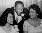 FILE- In this Aug. 9, 1965, file photo, Dr. Martin Luther King, Jr., president of the Southern Christian Leadership Conference, chats with his wife, Coretta, left, and civil rights champion Constance Baker Motley before the start of an S.C.L.C. banquet in Birmingham, Ala. The NAACP's Legal Defense Fund launched a $40 million scholarship program on Monday, Jan. 18, 2021, to create a new generation of civil rights lawyers. The Marshall-Motley Scholars Program, named for the legal defense fund's founder and Supreme Court Justice Thurgood Marshall, and his staff attorney Constance Baker Motley, who later became the first Black female federal judge. (AP Photo/File)
