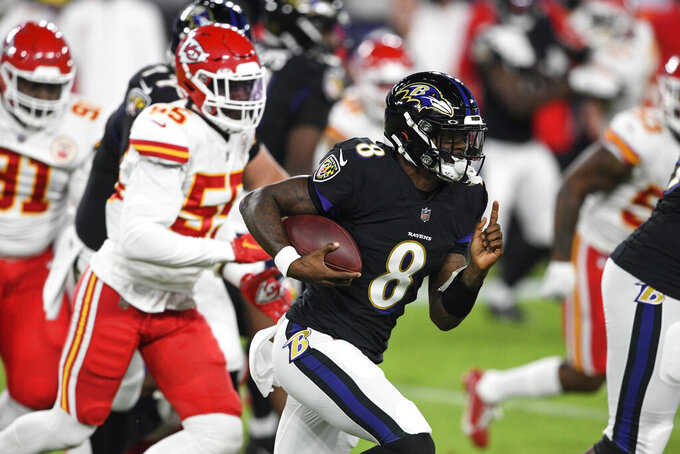 Baltimore Ravens quarterback Lamar Jackson (8) runs with the ball as he is pursued by Kansas City Chiefs defensive end Frank Clark (55) during the first half of an NFL football game Monday, Sept. 28, 2020, in Baltimore. (AP Photo/Nick Wass)