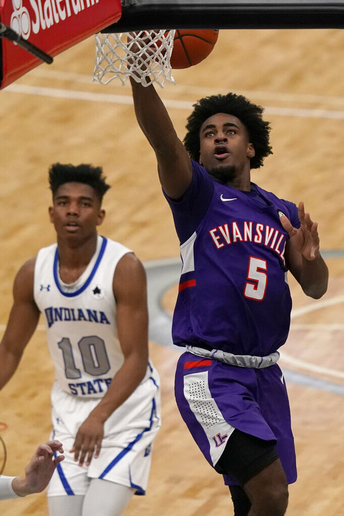 Evansville's Shamar Givance (5) shoots as Indiana State's Julian Larry (10) watches during the first half of an NCAA college basketball game in the quarterfinal round of the Missouri Valley Conference men's tournament Friday, March 5, 2021, in St. Louis. (AP Photo/Jeff Roberson)