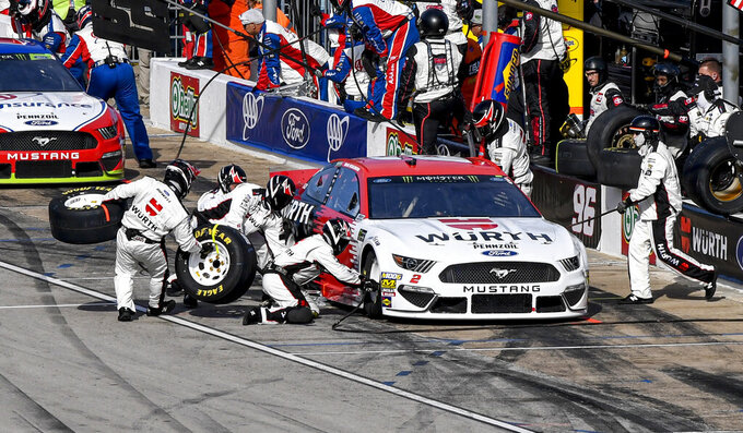 Brad Keselowski's (2) pit crew services his car during a NASCAR auto race at Texas Motor Speedway, Sunday, Nov. 3, 2019, in Fort Worth, Texas. (AP Photo/Larry Papke)