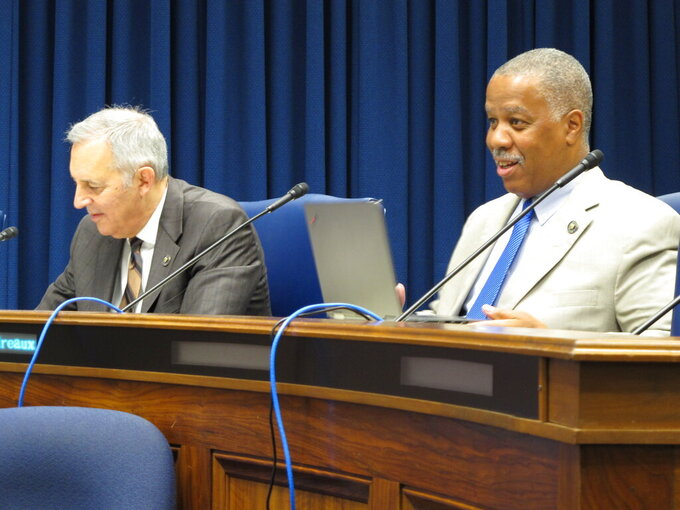Senators Mark Abraham, R-Lake Charles, left, and Gerald Boudreaux, D-Lafayette, listen to a discussion of the Senate's budget proposal during a meeting of the Senate Finance Committee on Monday, May 24, 2021, in Baton Rouge, La. (AP Photo/Melinda Deslatte)