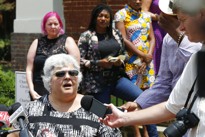 Susan Bro, mother of Heather Heyer, who was killed during the Unite the Right rally in 2017, speaks to reporters after the sentencing of James Alex Fields Jr., at General District Court in Charlottesville, Va., Monday, July 15, 2019. Fields was sentenced to life plus 419 years for his role in the 2017 Night The Right rally. (AP Photo/Steve Helber)
