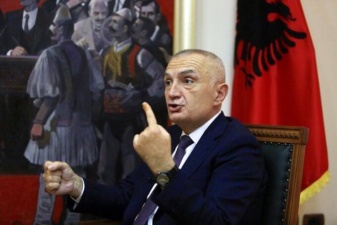 "Albanian President Ilir Meta speaks during an interview with the Associated Press in Tirana, Albania, Wednesday, April 21, 2021. Albania's president waded deep into the country's parliamentary election campaign Wednesday, accusing the left-wing government of running a ""kleptocratic regime"" and bungling its pandemic response. In an interview with The Associated Press, Ilir Meta also said he would step down if Prime Minister Edi Rama's Socialists — who are leading the main opposition conservatives in opinion polls — win Sunday's vote. (AP Photo/Hektor Pustina)"