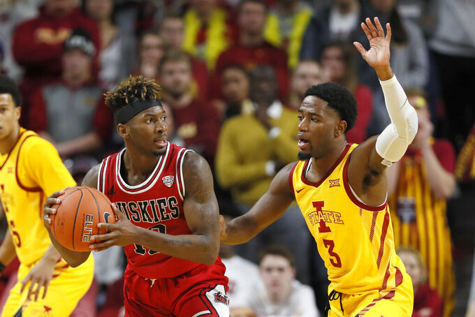 Northern Illinois guard Eugene German passes around Iowa State guard Tre Jackson, right, during the first half of an NCAA college basketball game, Tuesday, Nov. 12, 2019, in Ames, Iowa. (AP Photo/Charlie Neibergall)