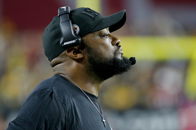 Pittsburgh Steelers head coach Mike Tomlin watches play during the second half of an NFL football game against the Arizona Cardinals, Sunday, Dec. 8, 2019, in Glendale, Ariz. The Steelers won 23-17. (AP Photo/Rick Scuteri)