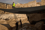 Workers on a construction site inside the Tower of David Museum in the Old City of Jerusalem, Wednesday, Oct. 28, 2020. Jerusalem's ancient citadel is devoid of tourists due to the pandemic and undergoing a massive restoration and conservation project. (AP Photo/Maya Alleruzzo)