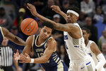 George Washington's Jameer Nelson Jr., left, and Saint Louis' Jordan Goodwin (0) chase the ball during the second half of an NCAA college basketball game Wednesday, Jan. 8, 2020, in St. Louis. (AP Photo/Jeff Roberson)