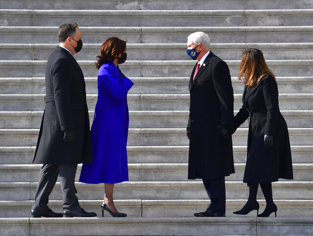Vice President Kamala Harris and husband Douglas Emhoff exchange words with former Vice President Mike Pence and wife Karen Pence on the east side steps of the U.S. Capitol after the 59th Presidential Inauguration in Washington on Wednesday, Jan. 20, 2021.  (David Tulis/Pool Photo via AP)