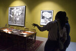 Works of art by South African artist William Kentridge are exhibited in Cape Town, South Africa, Friday, Aug. 23, 2019. Kentridge's work of evocative videos, graphic tapestries, charcoal drawings, woodcut prints, sculptures and immersive sound installations combine in his largest single show in which he explores compelling themes including the country's apartheid history and the participation of Africans in World War. (AP Photo/Trevor Samson)