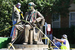FILE - Workers secure the statue of Confederate Naval officer Matthew Fontaine Maury to a truck on Monument Avenue, Thursday, July 2, 2020, in Richmond, Va. A Virginia special prosecutor has found no wrongdoing in the awarding of a $1.8 million contract for the removal of Richmond's Confederate statues last summer. The prosecutor said in a news release Wednesday, July 28, 2021, that he had reviewed the findings of a state police investigation and found no criminal activity.  (AP Photo/Steve Helber, File)