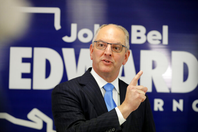 FILE - In this Thursday, Nov. 14, 2019 file photo, Louisiana Gov. John Bel Edwards talks to media at his campaign office in Shreveport, La. Gov. John Bel Edwards told the board overseeing Louisiana's largest university system Thursday, Dec. 5, 2019 that he will propose to again raise spending on public college campuses next year, trying to reverse nearly a decade of cuts. (AP Photo/Gerald Herbert, File)