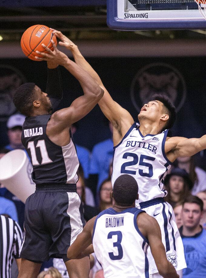 Butler forward Christian David (25) blocks the shot of Providence guard Alpha Diallo (11) during the first half of an NCAA college basketball game, Tuesday, Feb. 26, 2019, in Indianapolis. (AP Photo/Doug McSchooler)
