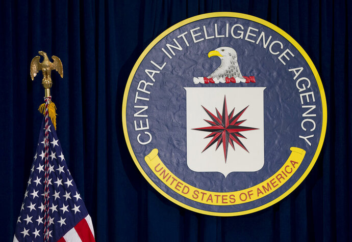 FILE - This April 13, 2016 file photo shows the seal of the Central Intelligence Agency at CIA headquarters in Langley, Va. Most stories about espionage are shrouded in secrecy due to the danger involved, but news organizations have been tested with the emergence of a potential spy's name. The issue involves the Russian official reportedly extracted from the country by the CIA two years ago. (AP Photo/Carolyn Kaster, File)