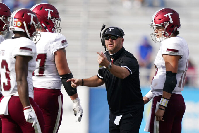 Troy head coach Chip Lindsey talks with his players in the first half of an NCAA college football game against Middle Tennessee Saturday, Sept. 19, 2020, in Murfreesboro, Tenn. Troy won 47-14. (AP Photo/Mark Humphrey)
