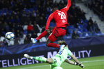 Salzburg's Patson Daka, right, gets the ball past Genk goalkeeper Gaetan Coucke to score the opening goal of the match during a Champions League group E soccer match between Genk and Salzburg at the KRC Genk Arena in Genk, Belgium, Wednesday, Nov. 27, 2019. (AP Photo/Francisco Seco)