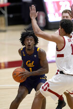 California guard Joel Brown (1) drives to the basket against Stanford forward Oscar da Silva (13) during the first half of an NCAA college basketball game in Stanford, Calif., Sunday, Feb. 7, 2021. (AP Photo/Tony Avelar)