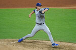 Kansas City Royals starting pitcher Brady Singer delivers in the seventh inning of the team's baseball game against the Cleveland Indians, Thursday, Sept. 10, 2020, in Cleveland. (AP Photo/Tony Dejak)