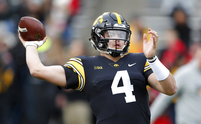 Iowa quarterback Nate Stanley warms up before an NCAA college football game against Nebraska, Friday, Nov. 23, 2018, in Iowa City, Iowa. (AP Photo/Charlie Neibergall)