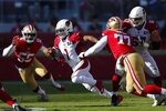 Arizona Cardinals quarterback Kyler Murray (1) runs between San Francisco 49ers defensive end Dee Ford (55) and defensive tackle Jullian Taylor (77) during the first half of an NFL football game in Santa Clara, Calif., Sunday, Nov. 17, 2019. (AP Photo/John Hefti)
