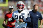 New England Patriots running back James White warms up during an NFL football practice, Saturday, July 31, 2021, in Foxborough, Mass. (AP Photo/Michael Dwyer)