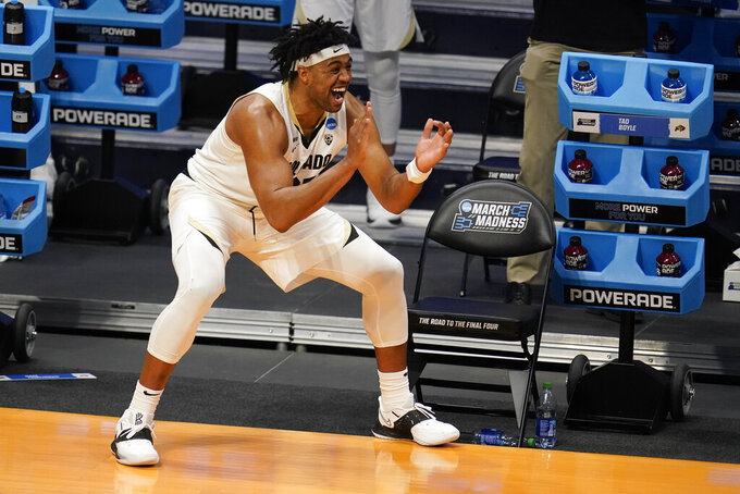 Colorado forward Evan Battey (21) celebrates on the bench in the second half of a first-round game against Georgetown in the NCAA men's college basketball tournament at Hinkle Fieldhouse in Indianapolis, Saturday, March 20, 2021. Colorado defeated Georgetown 96-73. (AP Photo/Michael Conroy)
