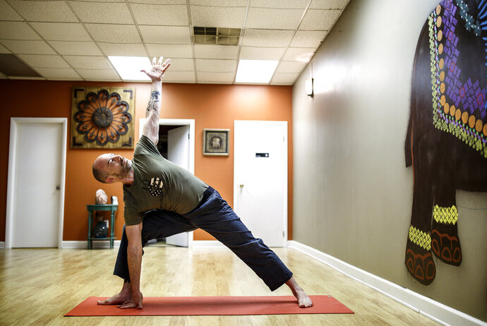 Army veteran Bryan Fant of Camp Hill, Pa., was in a tailspin of prescription painkillers, weight gain and depression when he discovered yoga, and turned his life around. May 21, 2019. (Dan Gleiter/The Patriot-News via AP)
