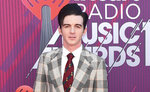 """FILE - Drake Bell arrives at the iHeartRadio Music Awards on March 14, 2019, in Los Angeles. Bell, one of stars of the popular Nickelodeon children's show """"Drake & Josh,"""" faces criminal charges regarding a girl he had met online and who attended a 2017 concert of his in Cleveland when she was 15. The 34-year-old actor pleaded not guilty Thursday, June 3, 2021, to felony attempted endangering children and misdemeanor disseminating matter harmful to juveniles. (Photo by Jordan Strauss/Invision/AP, File)"""