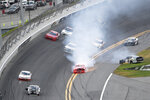 Justin Allgaier (7) drives along the apron with smoke coming out of his car after rear-ending Jeremy Clements (51), bottom left, in Turn 4 during a NASCAR Xfinity series auto race at Daytona International Speedway, Saturday, Feb. 15, 2020, in Daytona Beach, Fla. (AP Photo/Phelan M. Ebenhack)