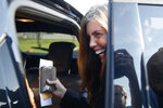 Former Pennsylvania Attorney General Kathleen Kane smiles as she enters an SUV to depart from the Montgomery County Correctional Facility in Eagleville, Pa., on Wednesday, July 31, 2019. Kane was sentenced in 2016 to 10-to-23 months for perjury, obstruction and other counts. (AP Photo/Matt Rourke)