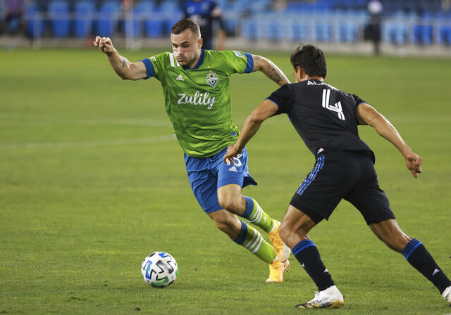 Seattle Sounders forward Jordan Morris (13) chases down a ball against San Jose Earthquakes defender Oswaldo Alanis (4) during the second half of an MLS soccer match, Sunday, Oct. 18, 2020, in San Jose, Calif. (AP Photo/Josie Lepe)