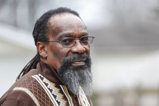 Walter Forbes poses for a photo in Belleville, Mich., Wednesday, Dec. 9, 2020.  Forbes, 63, walked out of Kinross Correctional Facility on Nov. 20 after Jackson County Circuit Court Judge Thomas Wilson overturned his arson and murder convictions earlier that month. (Junfu Han/Detroit Free Press via AP)