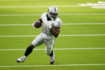 Las Vegas Raiders running back Jalen Richard runs with the ball during the first half of an NFL football game against the Los Angeles Chargers, Sunday, Nov. 8, 2020, in Inglewood, Calif. (AP Photo/Alex Gallardo)
