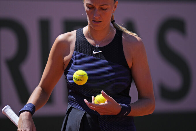 Czech Republic's Petra Kvitova watches tennis balls as she plays Belgium's Greet Minnen during their first round match of the French Open tennis tournament at the Roland Garros stadium Sunday, May 30, 2021 in Paris. (AP Photo/Thibault Camus)