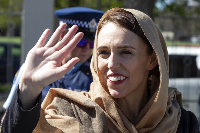 FILE - In this Sept. 24, 2020, file photo, New Zealand Prime Minister Jacinda Ardern waves as she walks from the Al Noor mosque in Christchurch, New Zealand where she unveiled a memorial plaque in memory of the victims of the March 15, 2019 Christchurch terror attack.  Opinion polls indicate Ardern is on track to win a second term as prime minister in a general election scheduled for Saturday, Oct. 17, 2020. (AP Photo/Mark Baker, File)