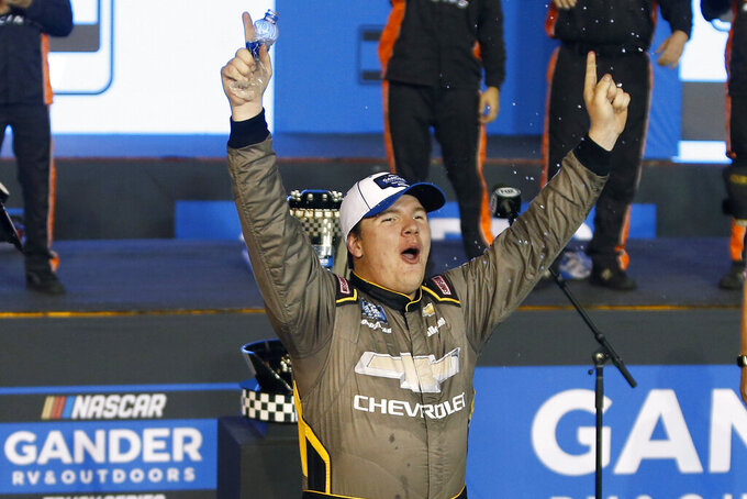 Sheldon Creed celebrates in victory lane after winning the season championship and the NASCAR Truck Series auto race at Phoenix Raceway, Friday, Nov. 6, 2020, in Avondale, Ariz. (AP Photo/Ralph Freso)