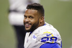 Los Angeles Rams defensive end Aaron Donald smiles as he stands on the sideline late in the second half of an NFL wild-card playoff football game against the Seattle Seahawks, Saturday, Jan. 9, 2021, in Seattle. (AP Photo/Scott Eklund)