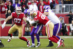 San Francisco 49ers defensive tackle DeForest Buckner (99) sacks Minnesota Vikings quarterback Kirk Cousins as 49ers defensive end Nick Bosa (97), left, moves in during the second half of an NFL divisional playoff football game, Saturday, Jan. 11, 2020, in Santa Clara, Calif. (AP Photo/Tony Avelar)