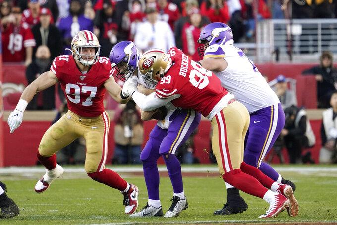 San Francisco 49ers defensive tackle DeForest Buckner (99) sacks Minnesota Vikings quarterback Kirk Cousins as 49ers defensive end Nick Bosa (97), left, moves in during the second half of an NFL divisional playoff football game, Saturday, Jan. 11, 2020, in Santa Clara, Calif. (AP Photo/Tony Avelar)