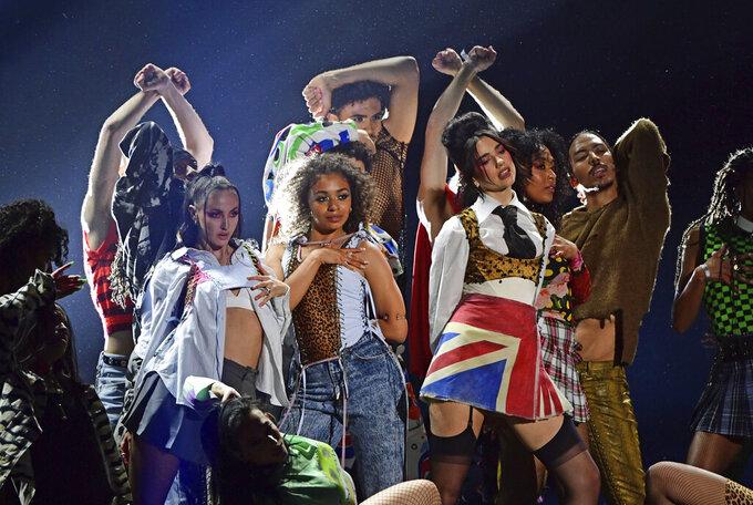 Dua Lipa performs during the Brit Awards 2021 at the O2 Arena, London, Tuesday, May 11, 2021. (Ian West/PA via AP)