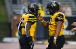 Appalachian State running back Marcus Williams Jr. (26) celebrates his touchdown with offensive lineman Noah Hannon (60) during the second half of an NCAA college football game against Louisiana Monroe Saturday, Oct. 19, 2019, in Boone, NC. (AP Photo/Brian Blanco)