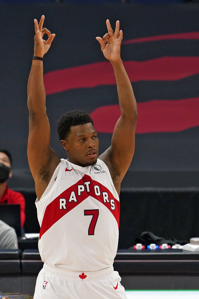 Toronto Raptors guard Kyle Lowry (7) celebrates a three-point basket during the second half of an NBA basketball game against the Denver Nuggets Wednesday, March 24, 2021, in Tampa, Fla. (AP Photo/Chris O'Meara)
