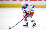 FILE - In this March 28, 2021, file photo, New York Rangers defenseman Adam Fox skates with the puck during the first period of the team's NHL hockey game against the Washington Capitals in Washington. Fox won the James Norris Memorial Trophy on Tuesday, June 29. (AP Photo/Nick Wass, File)
