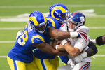 FILE - In this Sunday, Oct. 4, 2020, file photo, Los Angeles Rams linebacker Justin Hollins (58), left, and middle linebacker Micah Kiser (59), center, tackle New York Giants quarterback Daniel Jones (8) during an NFL football game, in Inglewood, Calif. The New York Jets and Giants are both 0-4 for the first time since 1976, and victories might be tough to come by this season. That has left the fans of both teams frustrated, disgusted and already looking to next season just four games into this season. (AP Photo/Kyusung Gong, File)