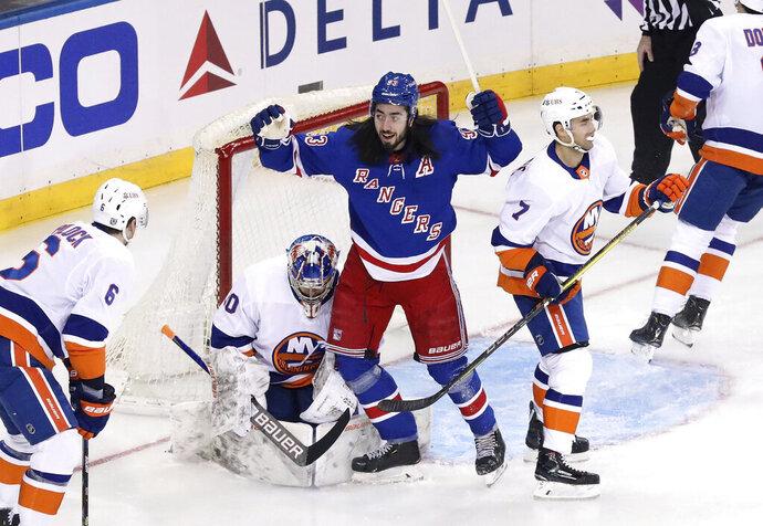 New York Rangers' Mika Zibanejad (93) celebrates a first-period goal by Pavel Buchnevich, not seen, against New York Islanders goalie Ilya Sorokin in an NHL hockey game Saturday, Jan. 16, 2021, in New York. (Bruce Bennett/Pool Photo via AP)