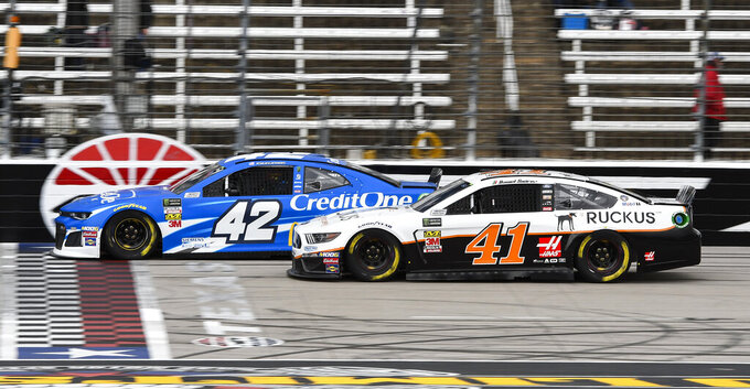 Drivers Kyle Larson (42) and Daniel Suarez (41) race down the front stretch during practice for a NASCAR Cup auto race at Texas Motor Speedway, Saturday, March 30, 2019, in Fort Worth, Texas. (AP Photo/Larry Papke)